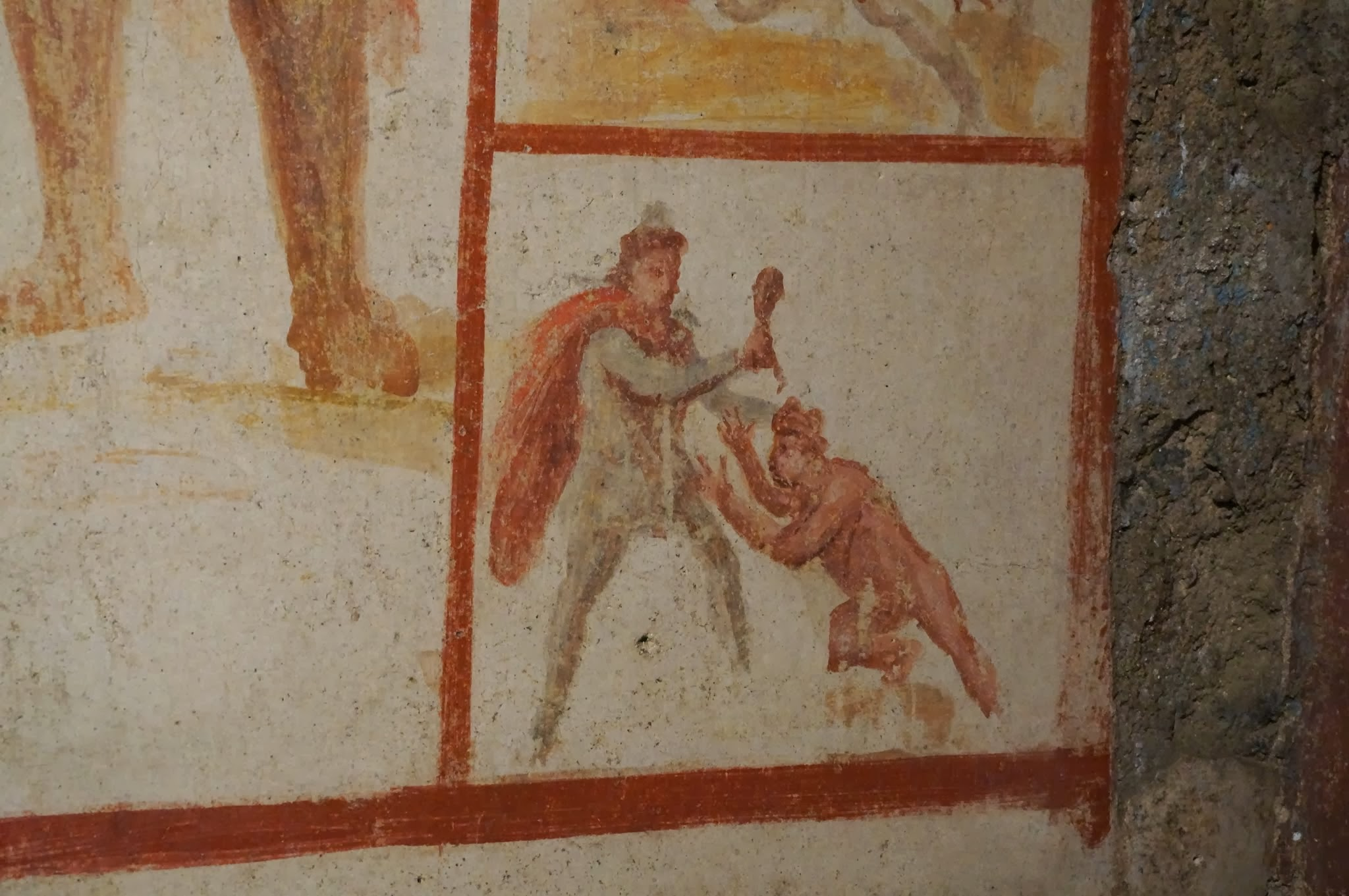 Detail of lower-right-hand corner of the Barberini Mithræum fresco tauroctony, showing Sol doing some kind of obeisance to Mithras, who is wielding the bull's shoulder (?)